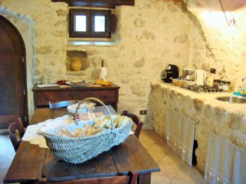 soggiorno  con angolo cucina